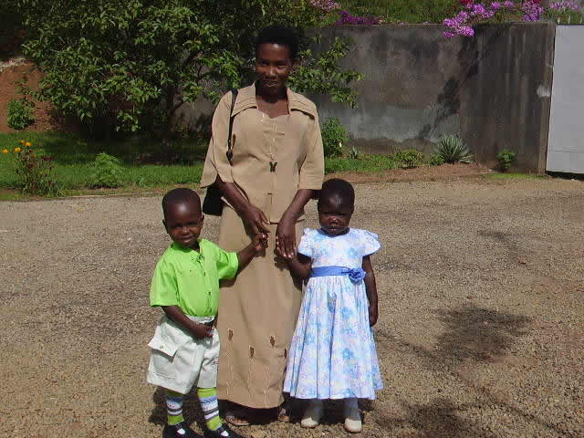 EWCV Teacher, Felly, and Two Children, Dressed for Church on Easter