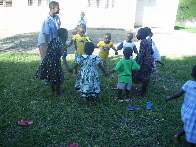 Volunteer, Mary Muwonge, Playing with Nine Children