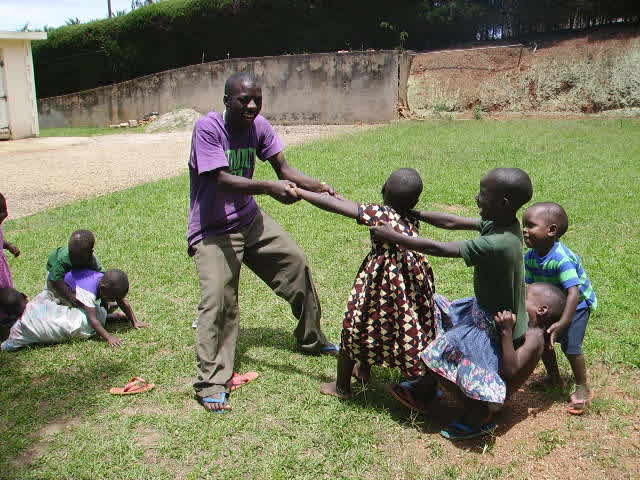 EWCV Night Watchman Playing Tug of War with Four Children