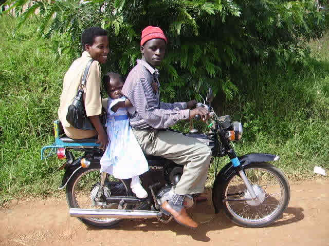 EWCV Teacher and Child Riding with Driver on a Boda Boda (motorcycle)