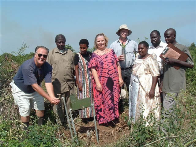Directors, Bill and Ann Peckham, with Ugandan Board, at Water Pipeline Coming into Eagles Wings Chidren's Village Property