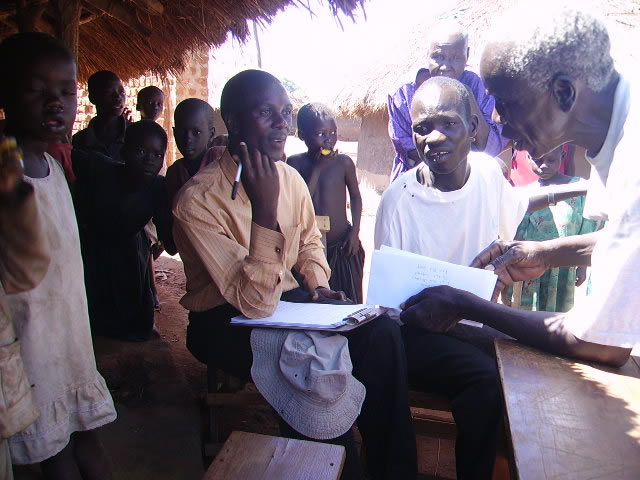 EWCV Social Worker, at IDP Camp,Writing Profiles Of Children For Sponsorship