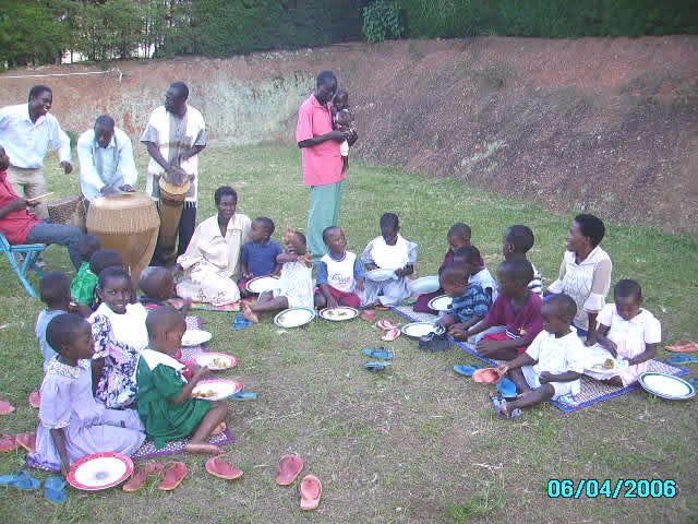 EWCV Children and Staff Eating Birthday Cake and Listening to African Drums