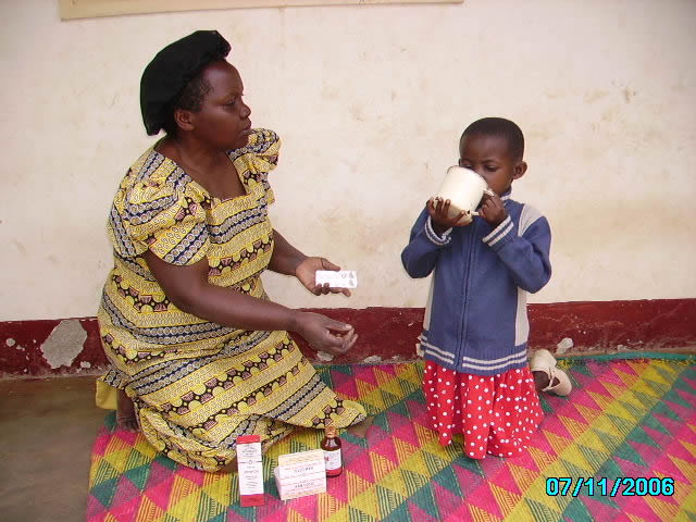 EWCV Girl Receiving Medicine from her House Mother