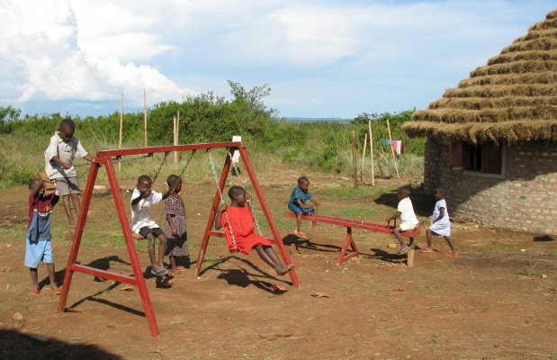 Eight Children Enjoying New Playground Equipment on EWCV Site