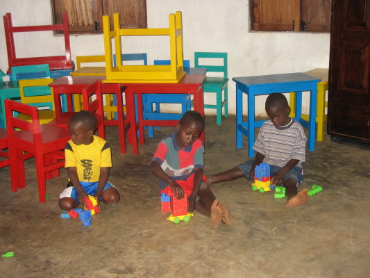 Three Boys Play with Blocks in the EWCV Dining Hut