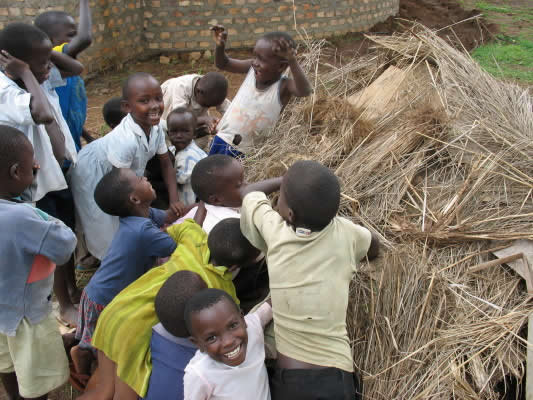 Fourteen Children Building a Little Hut