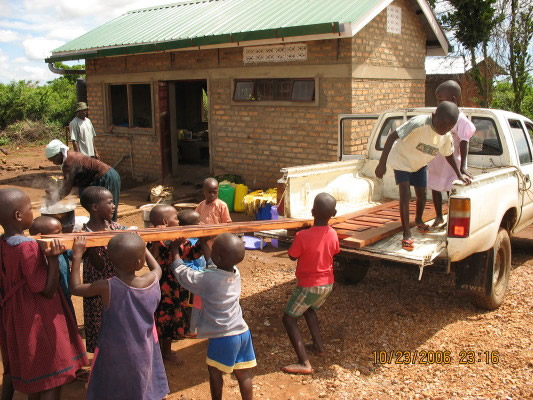 Children Helping to Unload Dining Hut Doors and Shutters