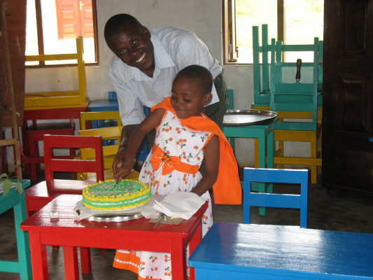 Allan and Birthday Girl Fatuma Cutting their Cake