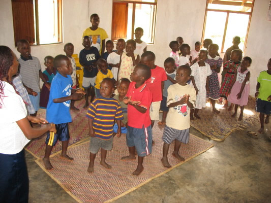 EWCV Children Singing in the Dining Hut at the End of the School Year