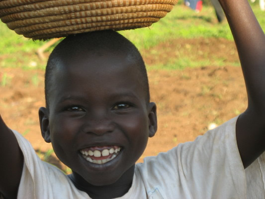 Smiling EWCV Boy with a Basket on his Head
