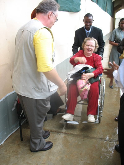Ann, in a Wheelchair, with Bill, at Entebbe Airport