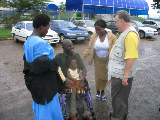 Bill Talking to Four Ugandan Friends