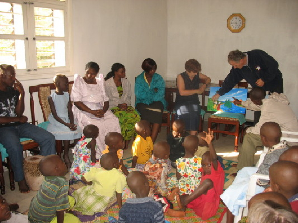 Aris and Mary Metaxakis Presenting a Bible Story to EWCV Children and Staff