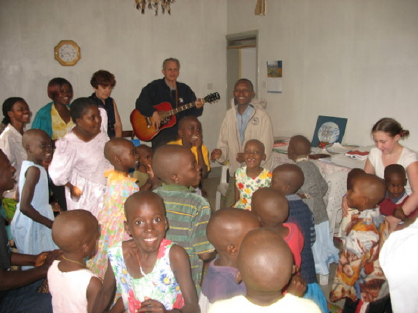 Aris Playing his Guitar for Family #2 Children and Staff