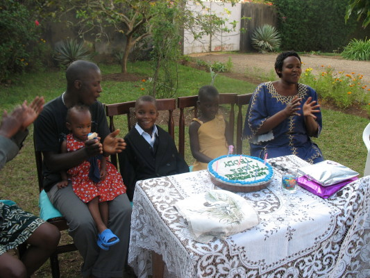 Two Staff Members and Three Children with their July Birthday Cake