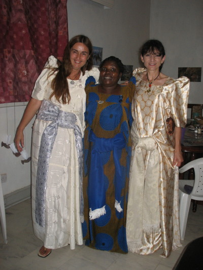 Volunteers, Martha and Karin, with Harriet Muwonge, All Wearing Gomez Dresses