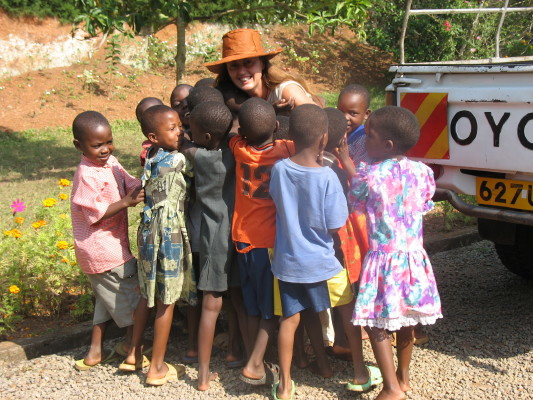 Volunteer Getting Goodbye Hugs from Children