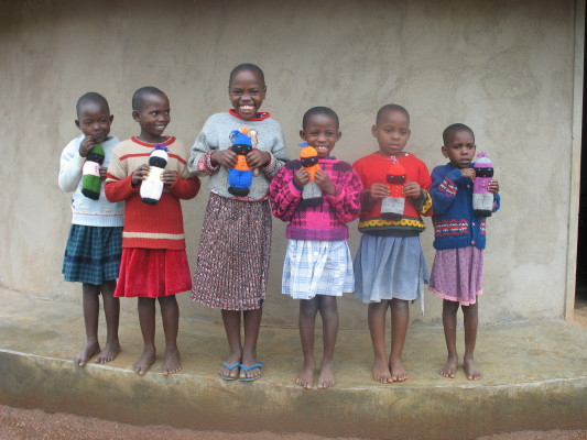 Six More Girls from Family #1 with their knitted dolls.