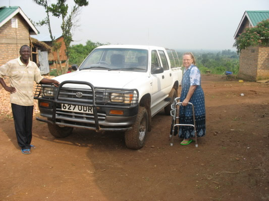 EWCV White Truck with Ann and a Staff Member Standing Beside It
