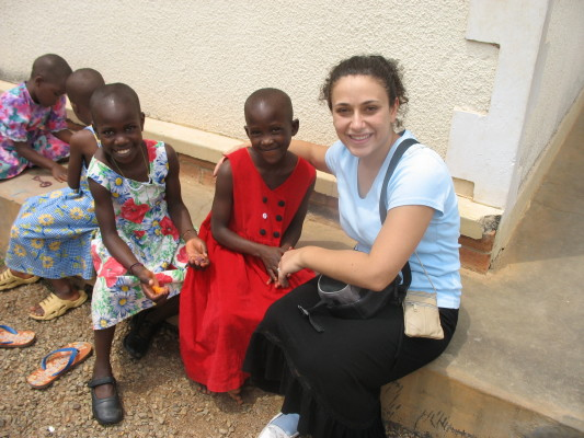 Volunteer, Angela, Sitting Outside with Two EWCV Girls