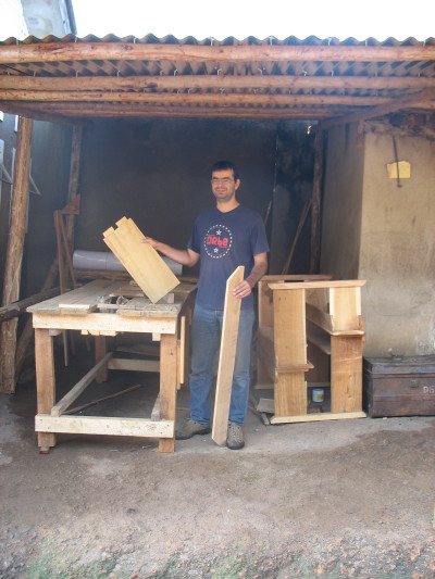 Greek Volunteer Assembling Desks in EWCV Carpentry Shop