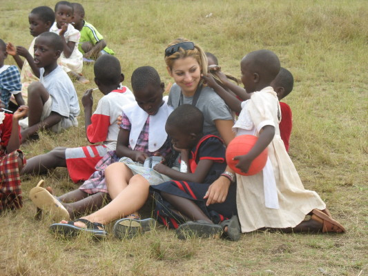 Five EWCV Children Cuddling with volunteer, Katerina