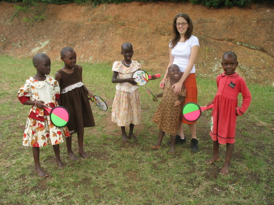 Volunteer Playing Ball and Racket Game with Five EWCV Girls
