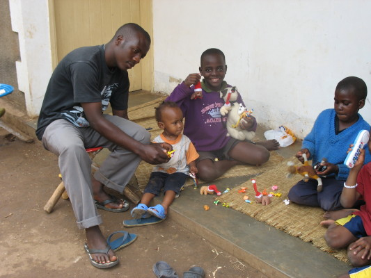 EWCV Staff, Moses, Explaining New Toys to Three Children