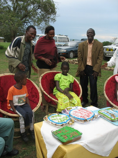 Children and Staff Celebrating Birthdays with Cakes at the Park