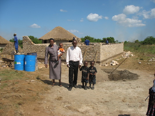House Parents and Three Children at Family #2's Construction Site