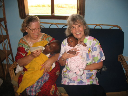 Ann and Janet (from Alaska) Holding Babies at Kasana New Hope Orphanage