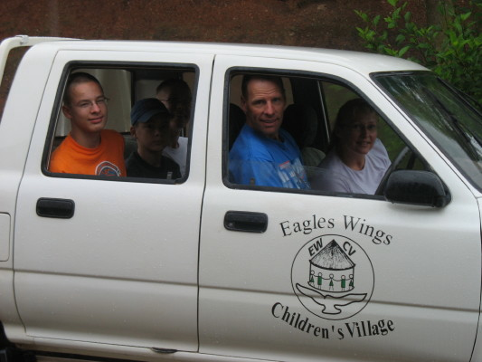 Eagles Wings Children's Village Logo on White Truck's Door