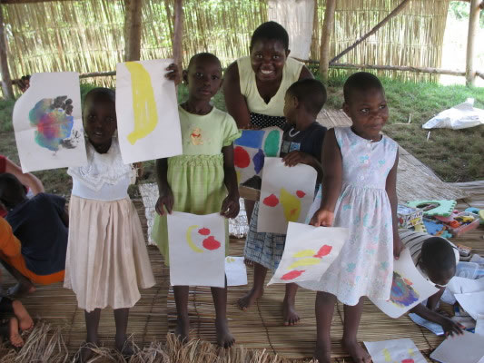 Rachael and Four Nursery Children Displaying Picture They Painted