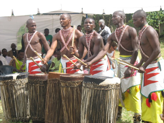 Five Rwandan Men Drumming and Dancing at a Graduation Ceremony