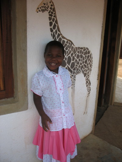 Smiling EWCV Child, Shakira, in her Pink and White Birthday Dress