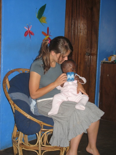 Susy Feeding Baby at Kasan New Hope Orphanage
