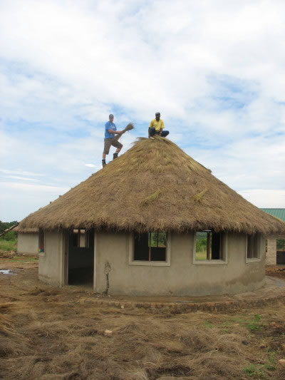 Volunteer, Walter. and EWCV Staff Member Thatching Dining Hut