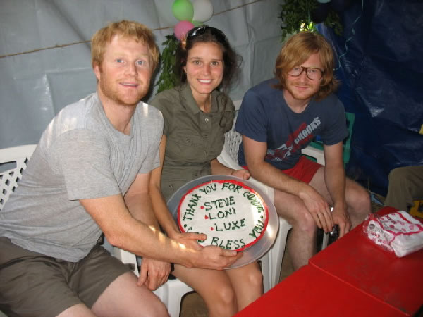 Three Volunteers with Farewell Cake