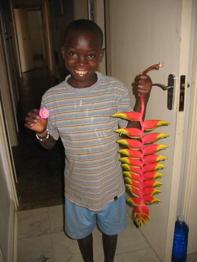 "EWCV Boy Holding ""Bird of Paradise"" Flower"