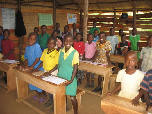 Children Standing at their Desks in the Temporary Beth Pipe Nursery and Primary School