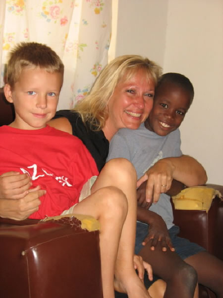 Volunteer Marilyn with Son, Joshua, and EWCV child, Frank