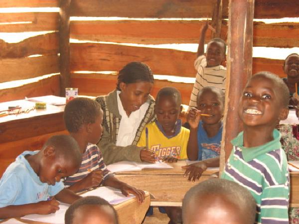 EWCV Teacher Helping the Children Learn To Print