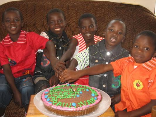 Five EWCV Cutting their Birthday Cake