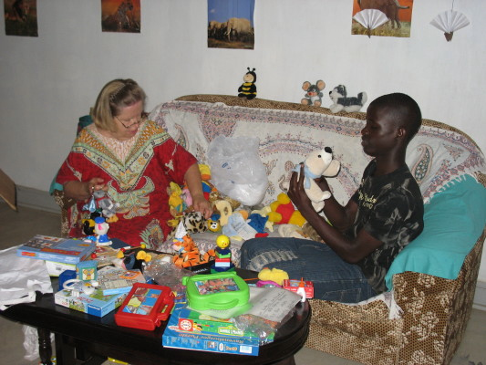 Ann and an EWCV youth sort toys for use by Nursery and Primary One students.