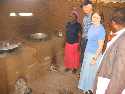 EWCV Canadian Board, Ken Buhler, and his Wife, Marg, Chatting with the School Cook and Rev. Muwonge.