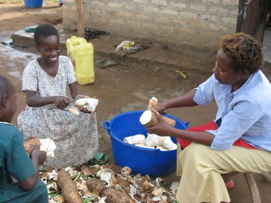 Two EWCV Children Helping the Cook Peel Cassava