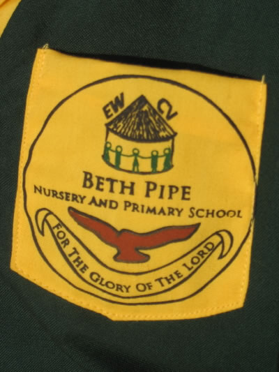 "School Uniform Pocket with EWCV Logo, the Words, ""Beth Pipe Nursery and Primary School"" and a Bbanner that Reads ""For the Glory of the Lord"""