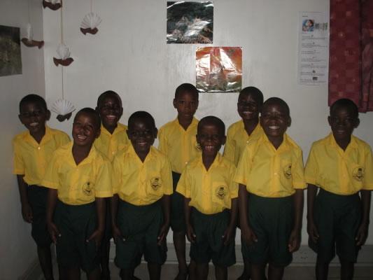 Boys in EWCV School Uniforms - Yellow Shirts and Green Shorts