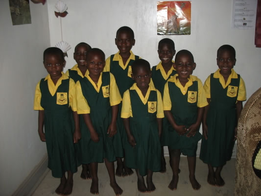 Girls in EWCV School Uniforms - Yellow Shirts and Green Jumper Dresses